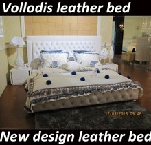 Vollodis white king size leather tufted upholstery bed