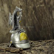 Metal dragon standing on helmet