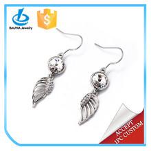 Silver colored hook round crystal rhinestone wing dangle earrings