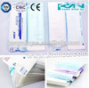 Self sealing flat sterilization pouches for dental device