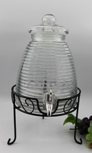 glass honey dispenser with tap lid and iron stand