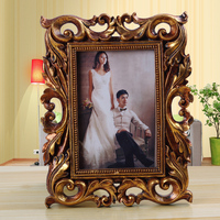 2015 hot sale resin modern picture frame Golden mini memory frame European style high quality 4x6 hollow out 0.3kg curved BY001