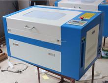 prezzo più basso liaocheng co2 piastrelle di ceramica macchina di taglio laser