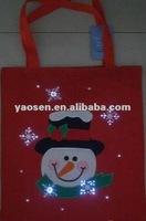 Red christmats felt gift bag with fiber optical light