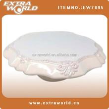 round white ceramic pedestal cake plate with decoration