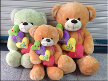 nHot Sale Custom Logo Skins Soft Toy Plush Teddy Bear With Pillow Heart,plush teddy bear