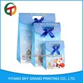 Diseño moda OEM made in china de regalo de papel barato bolsa