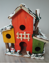 colorful wooden decorated bird house for Christmas