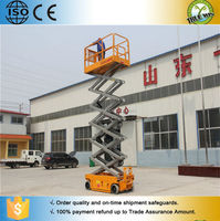China IBS 2015 12m Mobile Vertical Lifter / 4 Wheel vetical cargo transporter / Self propelled scissor lift