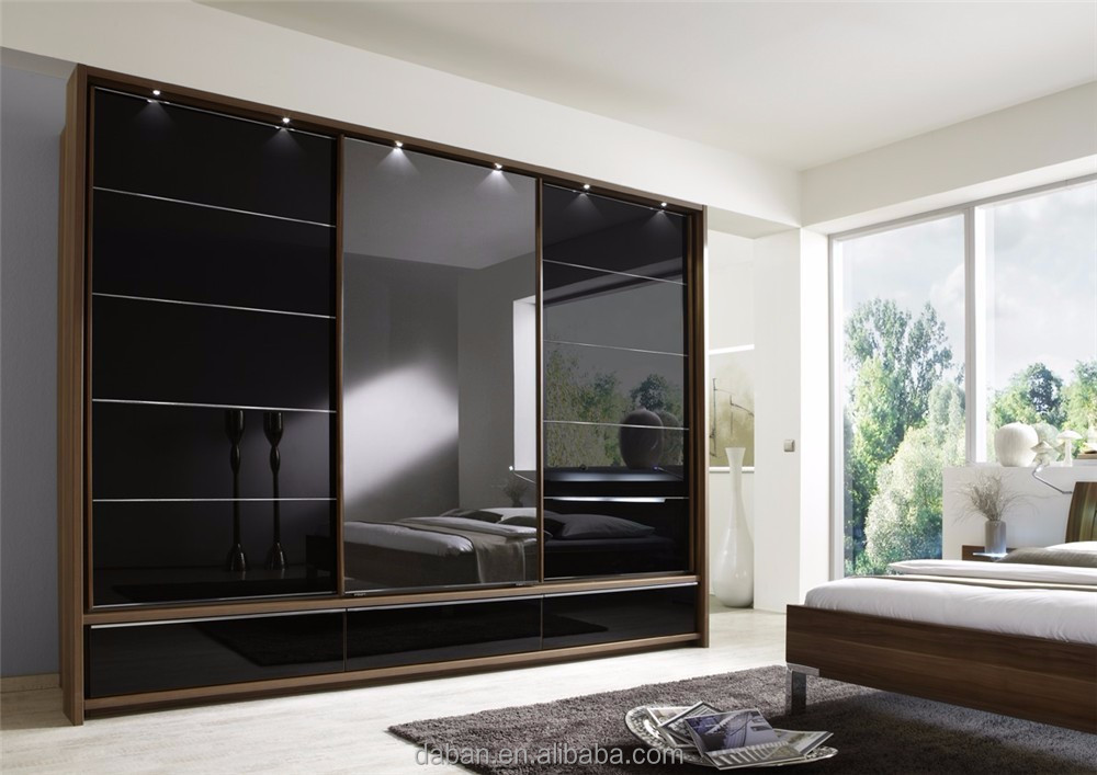Sliding black wardrobe door company built in bedroom for Built in sliding doors