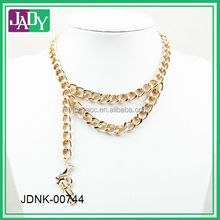 gold chain necklace with gun