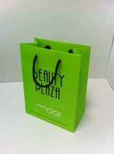Green paper shopping bag with recycled paper
