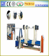 Hydraulic shaftless paperboard mill roll stand corrugated cardboard production line