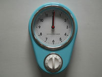 Plastic wall clock with kitchen timer