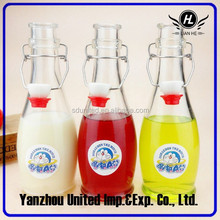 Hot sale 350ml clear bowling ball shape glass beverage bottle with swing top