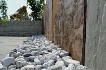 landscaping and gardening used white pebble/cobble stone