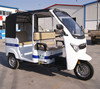 motor rickshaw; electric tricycle with passenger seat