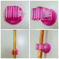 Suction cup mop and broom holder Bathroom organization