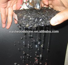 water through test of black Perma paver made of pebbles,glue stone, gravel Eastwood stone