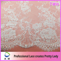 Delicate design floral white eyelash lace fabric for making bridal dress wholesale