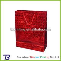 Red metallic paper gift bags