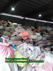 Second hand clothes in bales container of used clothing manufacturers