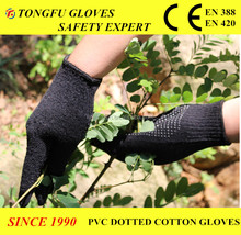 7/10 gauge black color cotton knitted protection gloves with palm PVC dots in one side