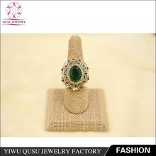2015 yiwu new product gold plated ring with oval bottom tip of the emerald zircon
