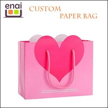 China supplier luxury pink printed custom kraft paper gift bag with handles for girl