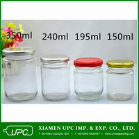 Empty round clear glass jars with screw top lids