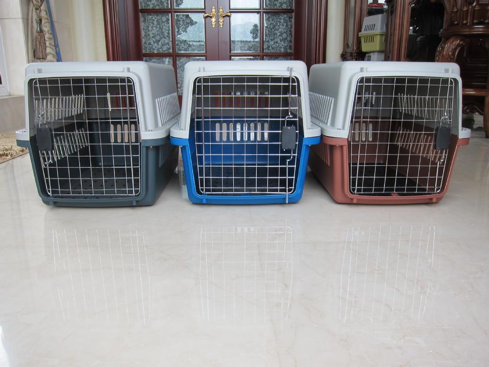 Plastic pet kennel with metal door