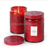scened candle in embossed glass jar