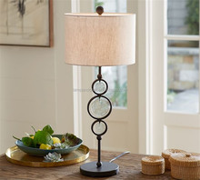 hand finished sculptural base and recycled glass metal lamp sophisticated circular silhouettes with whimsical glass accents