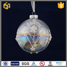 Selling white flower stuck on a transparent glass ball, Christmas ornament ball