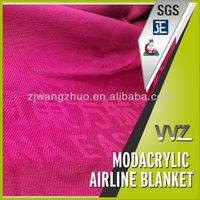 dark red color Modacrylic flame retardant airline blankets with airline's name and logo inter woven in the blanket