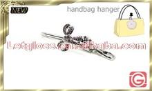 2015 newest zinc alloy Ribbon shaped vintage bag holder