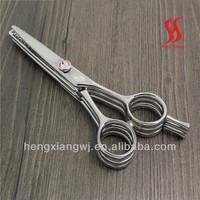 Triple bladed hair scissors