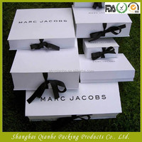 Luxury fashionable paper clothes gift packaging with ribbon