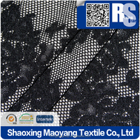 KNITTED POLY DOUBLE JACQUARD STRETCH FABRIC IN BLACK+P/D