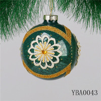 THe colourful christmas glass ball with flower fabric outside