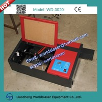 50w 3020 mini laser machine for rubber seal, small artworks with up-down lift