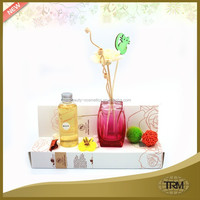 Pink perfume bottle reed diffuser