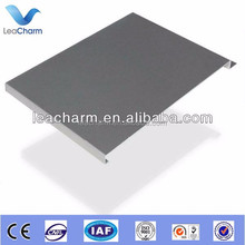 Store suspended F 300 pressed metal strip ceiling panels