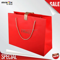 Wholesale custom gift paper bag with pp handle and ribbon
