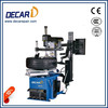 Automatic tyre assembly machine with assistant arm