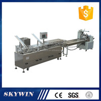 Easy operation one line one colour 2+1 biscuit sandwiching creaming food with flow packaging machine