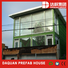 Green modified container house with big french windows for spa