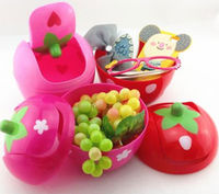 strawberry shaped plastic trash can