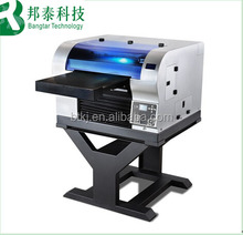 A2 desktop uv led flatbed printer multifunctional for printing pen, glass, metal, pvc card, t-shirt, phone cases 5760 * 2880 dpi