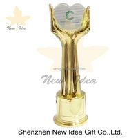metal hand logo trophy awards with shining gold surface treatment for unity hand metal trophy